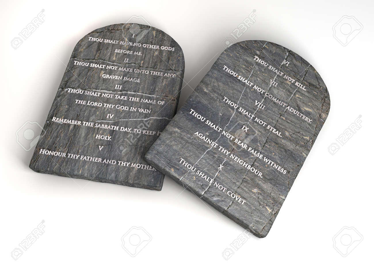 Two stone tablets with the ten commandments inscribed on them on an isolated background - 15445873