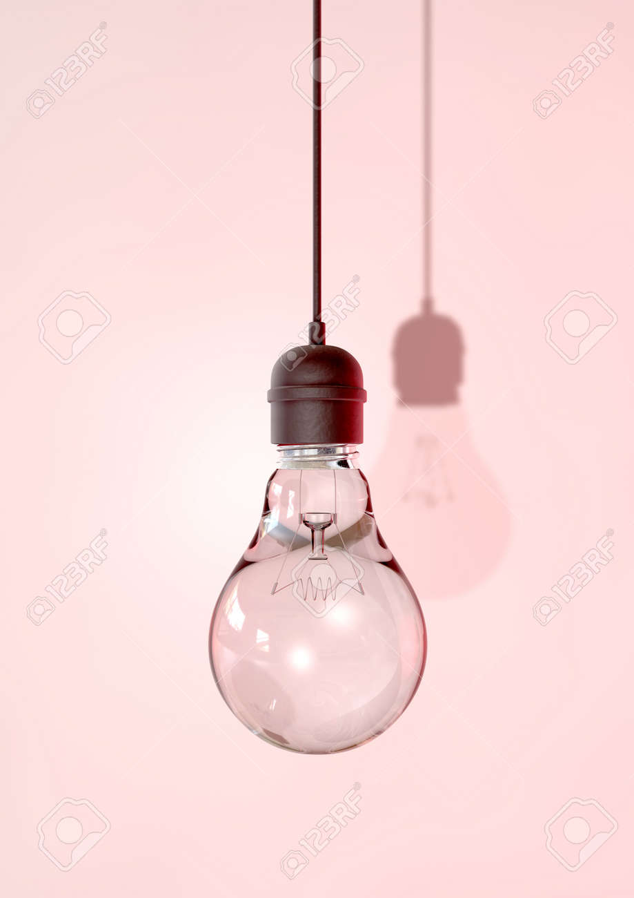 A regular unlit light bulb fitted into a light fitting hanging from a chord on an isolated background Stock Photo - 16135578