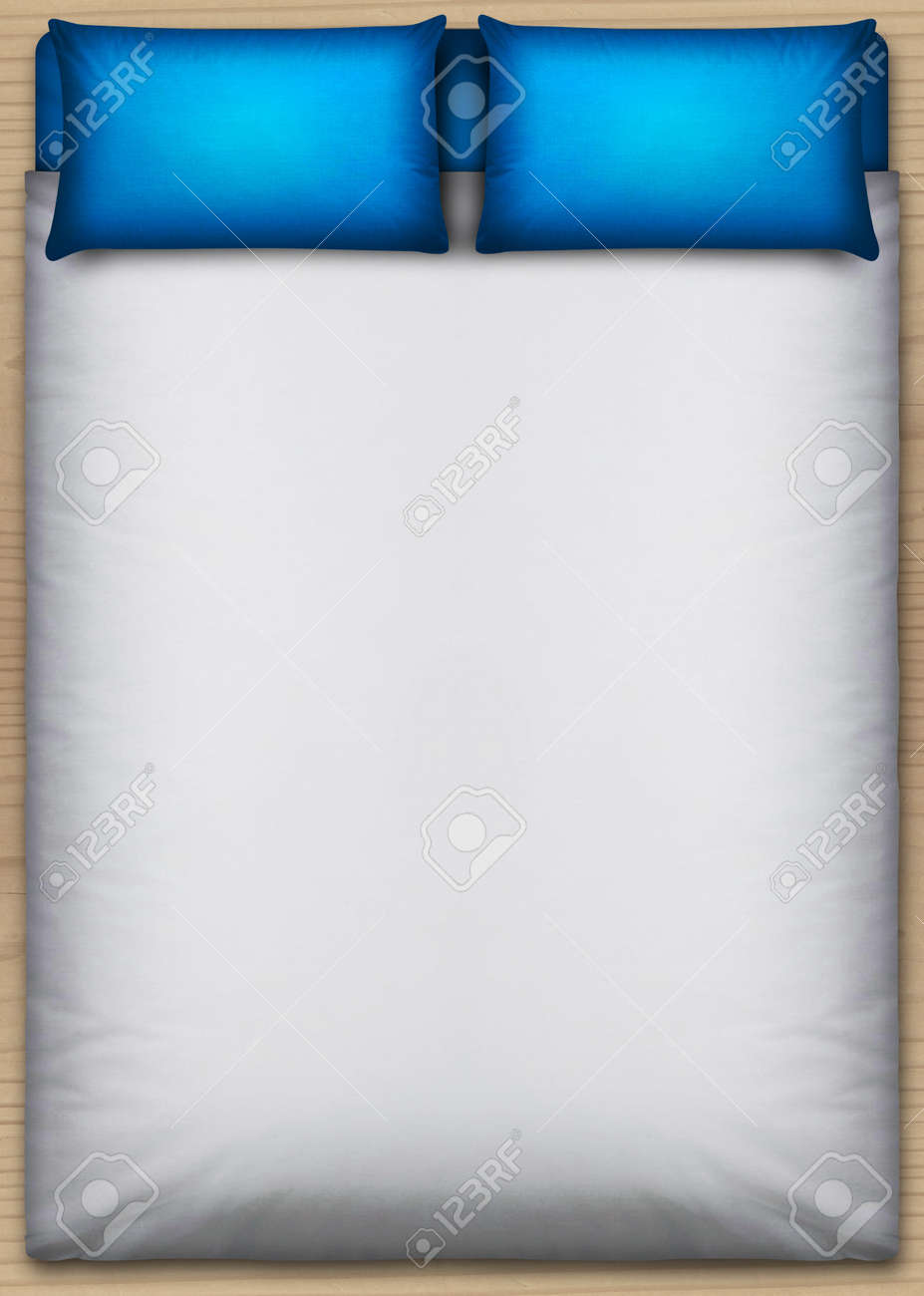 A direct top view from above a perfectly neat bed with a white duvet and two blue pillows on a wooden floor Stock Photo - 21639110