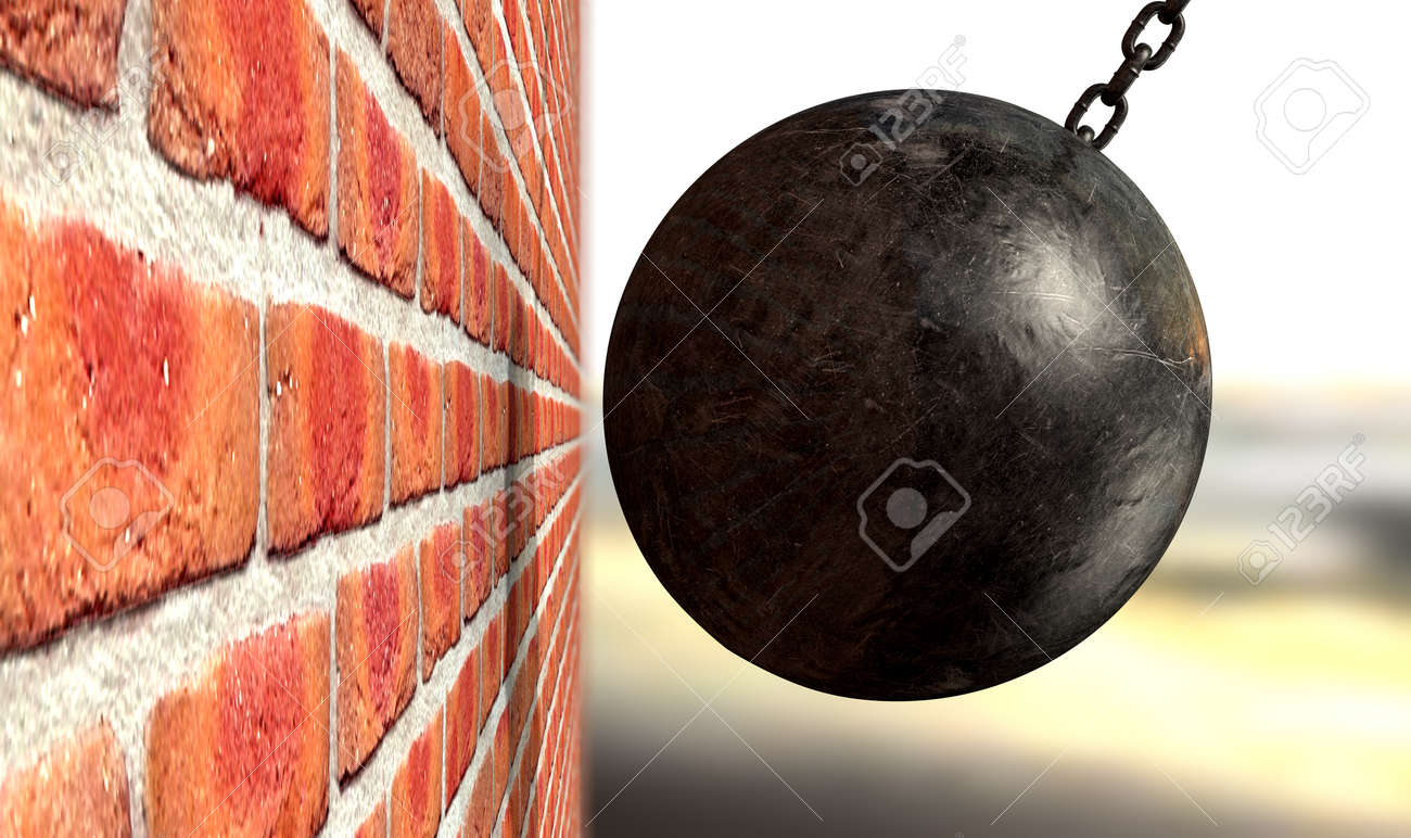 A regular metal wrecking ball attached to a chain hitting and breaking a face brick Stock Photo - 25173725