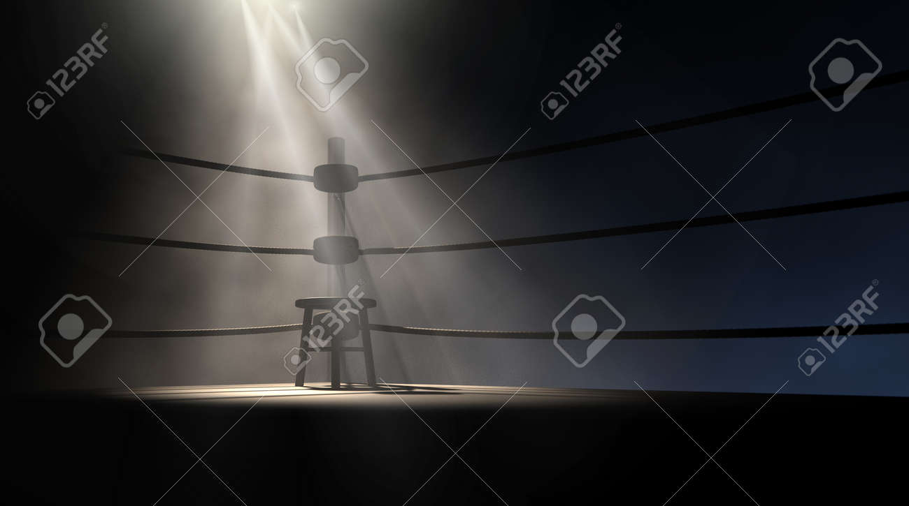 A dramatic view of the corner of an old vintage boxing ring with