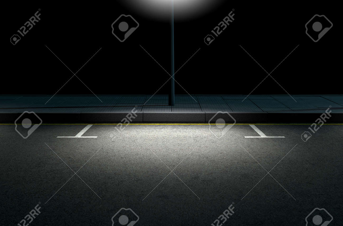 A section of a tarmac road with demarcated parking areas next to a pavement lit by a street pole at night - 52526514