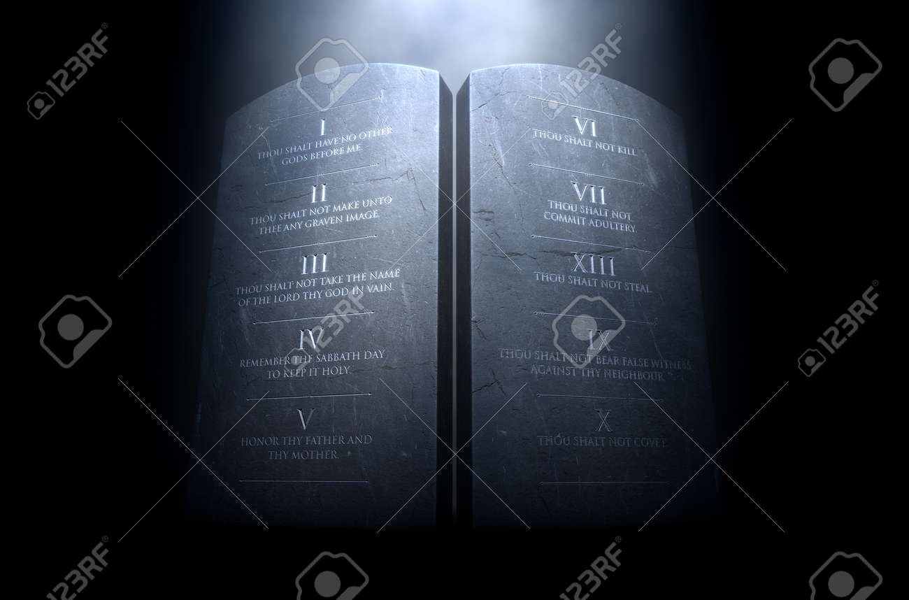 A 3D render of two stone tablets with the ten commandments etched on them lit by a dramatic spotlight on a dark background - 68757822