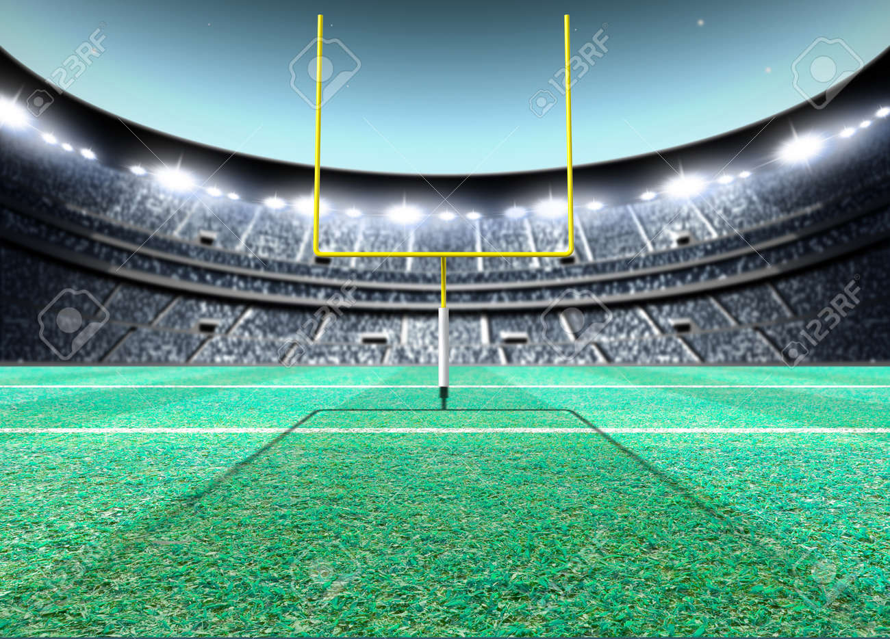 A generic seated american football stadium with yellow goal posts on a green grass pitch at night under illuminated floodlights - 3D render - 71562645
