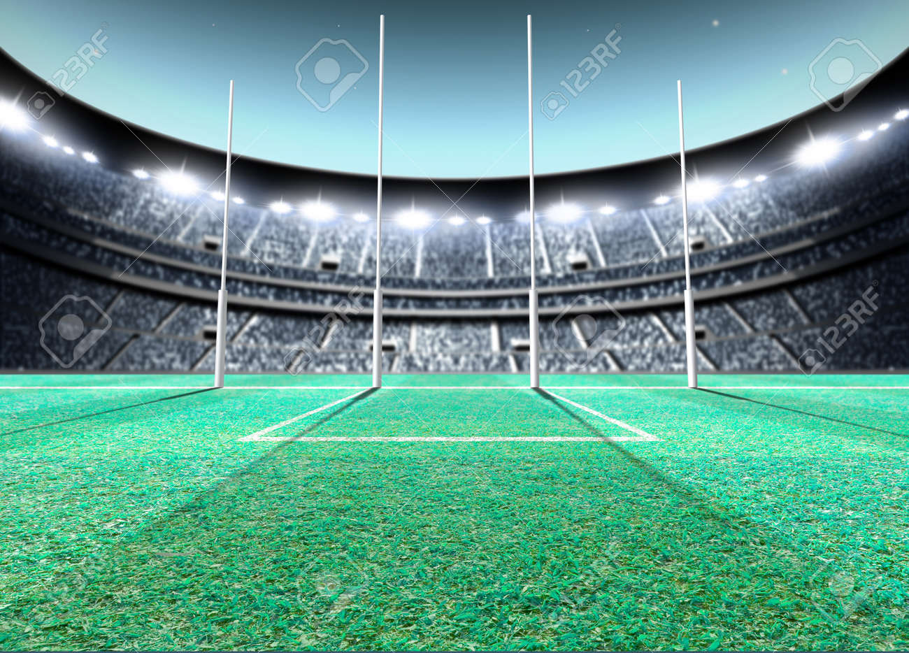 A generic seated aussie rules stadium showing goal posts on a green grass pitch at night under illuminated floodlights - 3D render - 71563508