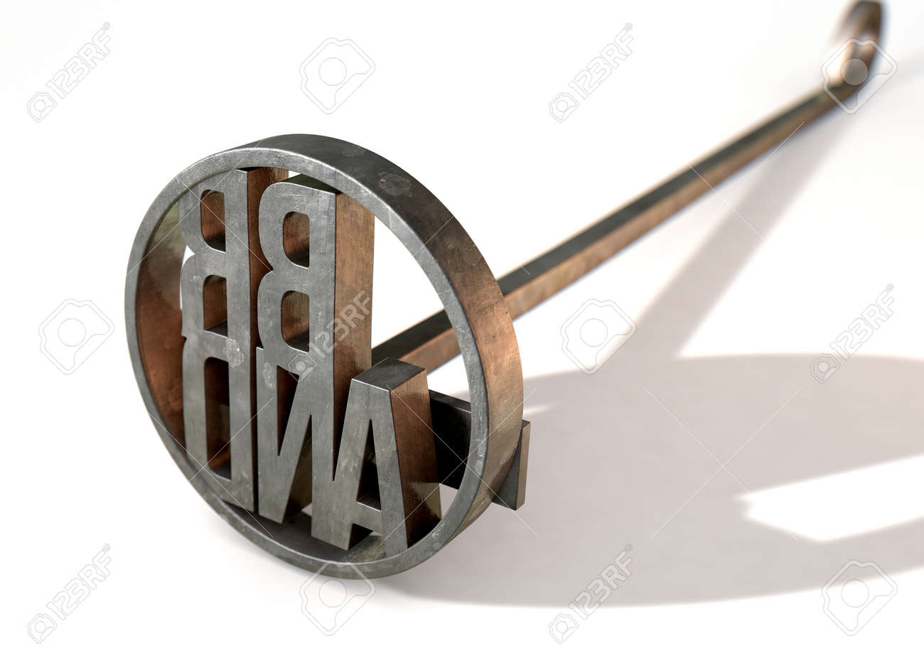 A metal cattle branding iron with the word brand as the marking area on an isolated white surface - 3D render - 73974491