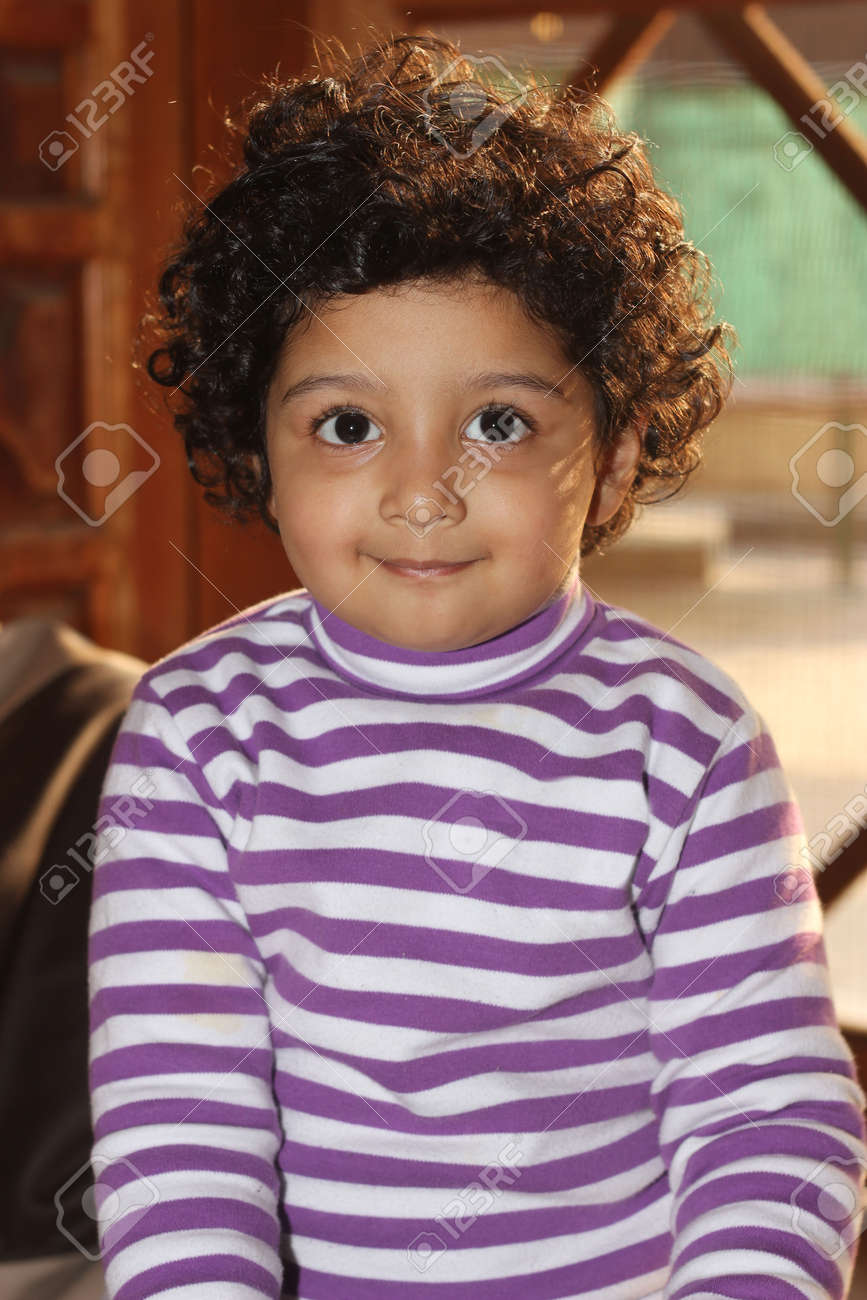 Cute Curly Hair Light Skin South Asian Boy Smiling Wearing White Stock Photo Picture And Royalty Free Image Image 67746754
