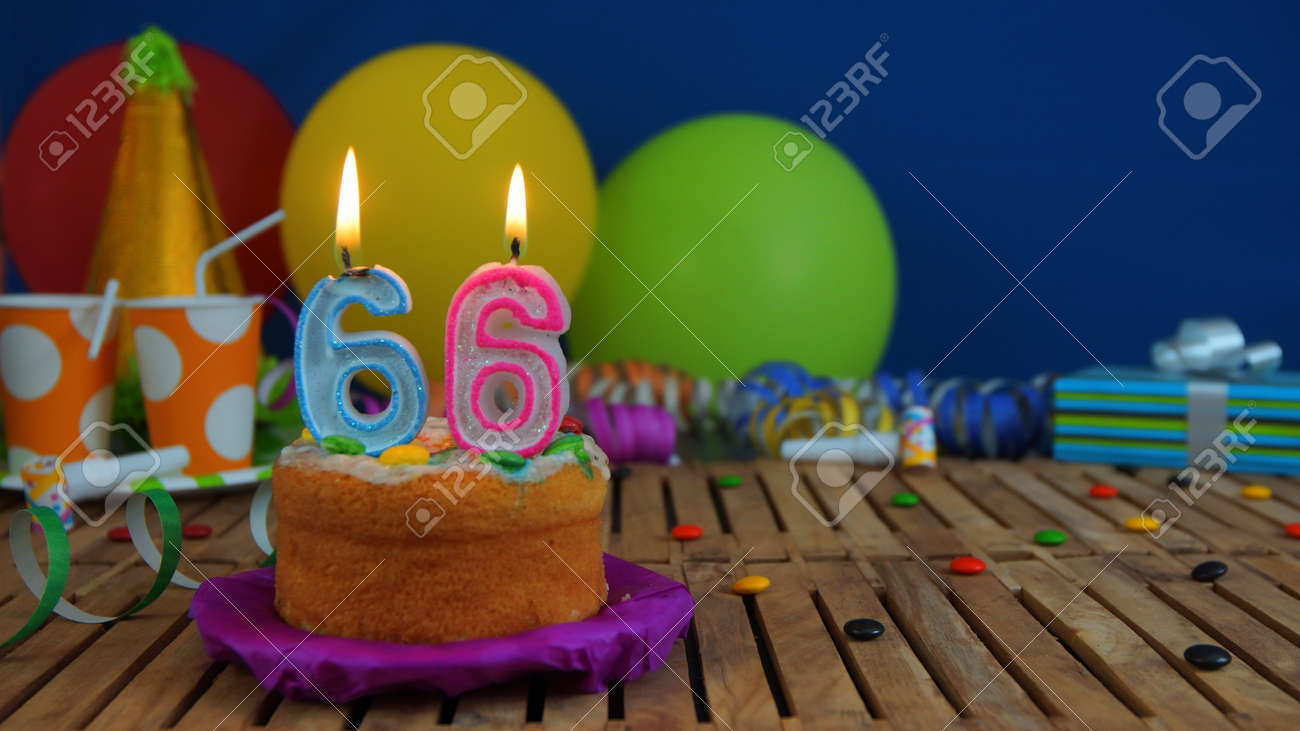 Birthday Cake With Candles On Rustic Wooden Table Background Of Colorful Balloons Gifts
