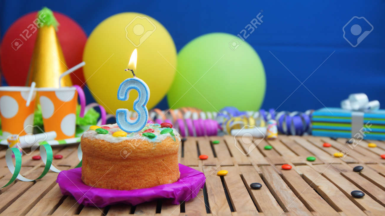 Birthday Cake With Candles On Rustic Wooden Table With Background