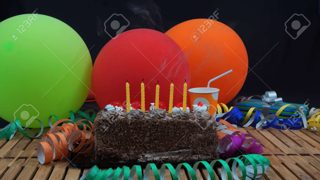 Chocolate Birthday Cake With Five Yellow Candles Extinguished