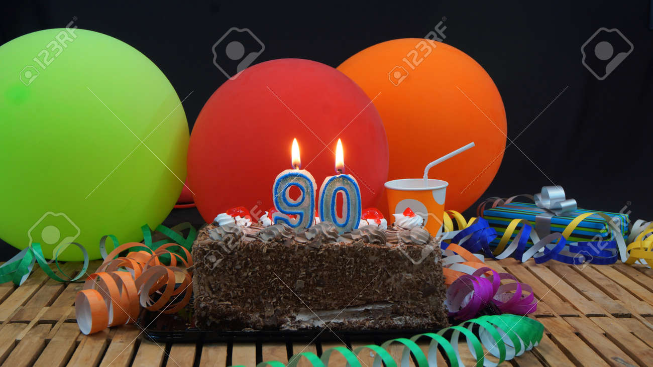 Chocolate Birthday Cake With Candles Burning On Rustic Wooden