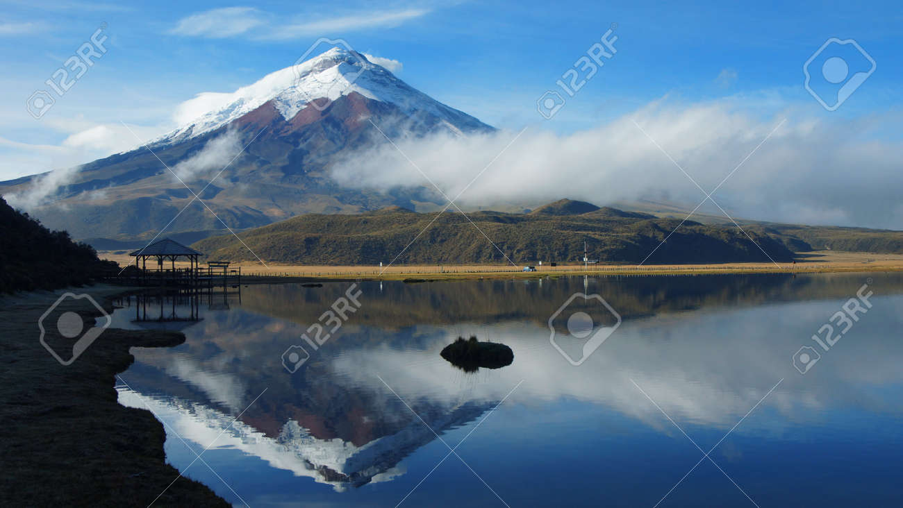 View of the Limpiopungo lagoon with the Cotopaxi volcano reflected in the water on a cloudy morning - Ecuador - 83915485