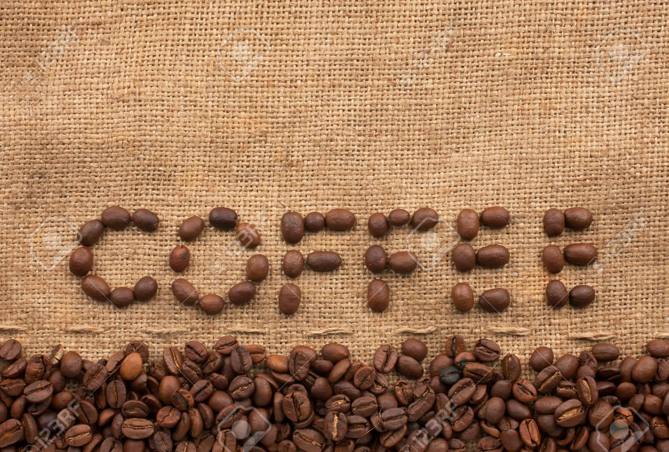 The word coffee made from coffee beans on sackcloth next to coffee beans Stock Photo - 15819848