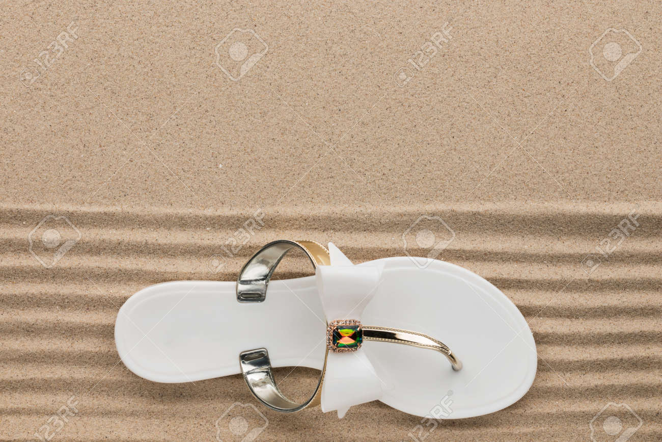 9121d3e6f1815 Stock Photo - Trendy white flip flops decorated with rhinestones