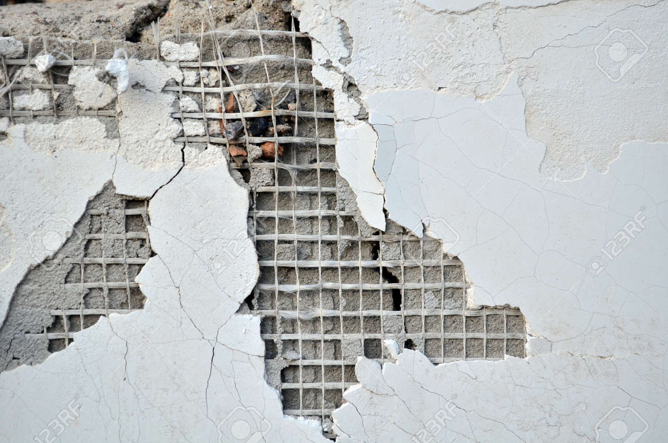 fragment of a damaged plaster wall in abandoned house - 153875354