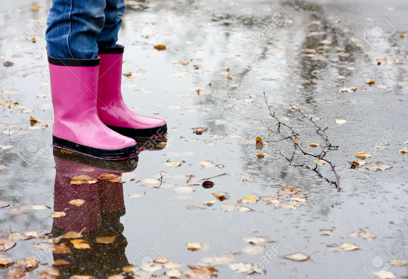 Boots In A Puddle Stock Photo, Picture And Royalty Free Image ...