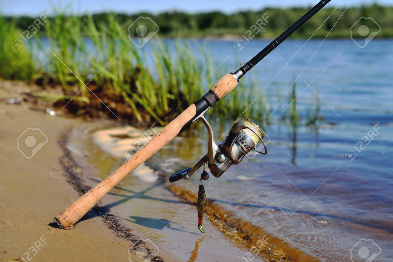 spinning on the bank of the river fishing line silicone bait