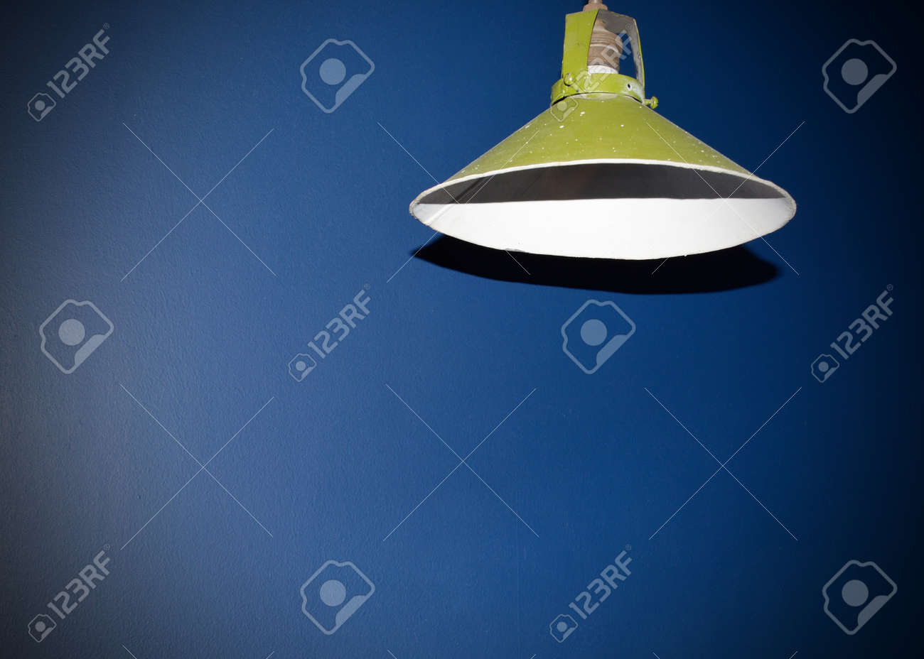 Round Green Lampshade hanging on the ceiling in the room. Stock Photo - 73494630