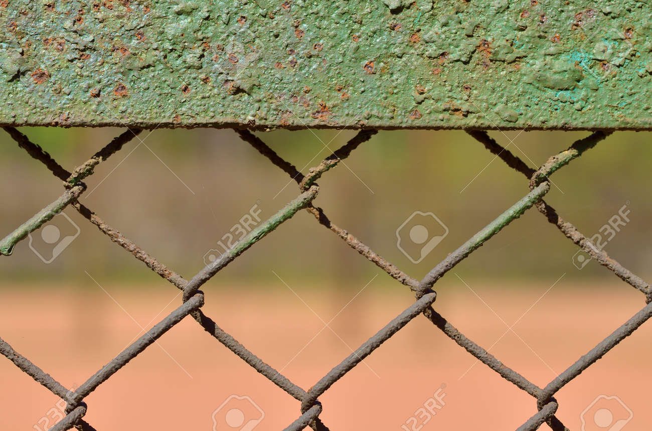 A Fence Made Of Iron Net. The Wire Is Twisted Into A Rigid Mesh ...