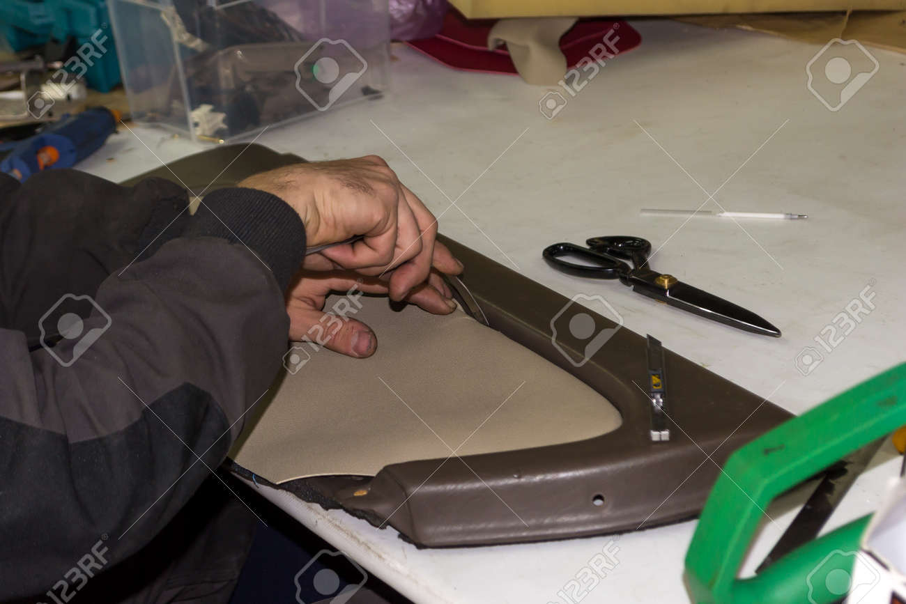 A Male Worker Does Manual Work On Skinning A Genuine Leather Of A