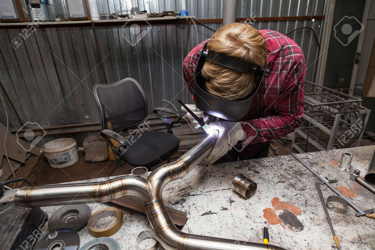 Young Guy Welder In A Checkered Red Shirt Welds A Stainless Steel Stock Photo Picture And Royalty Free Image Image 130602740