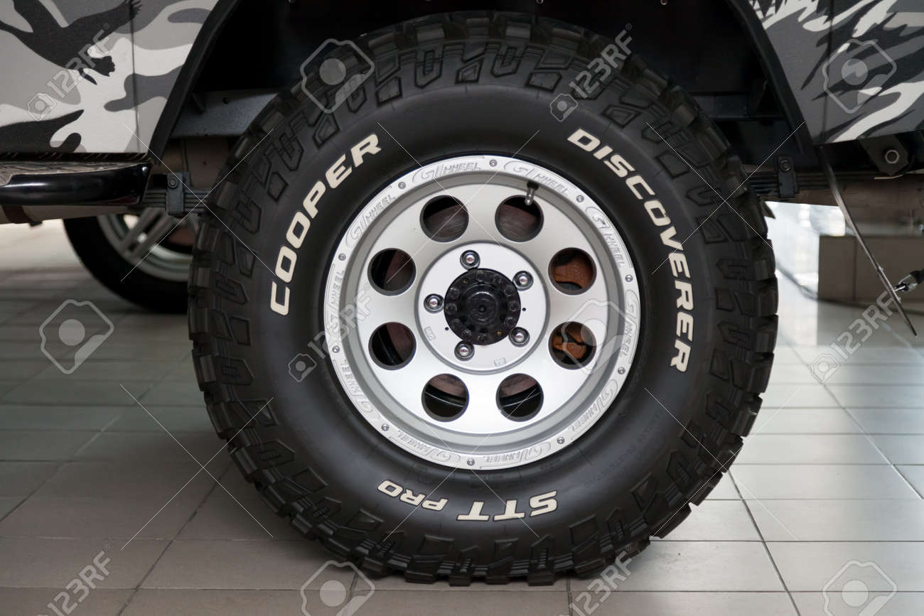 Novosibirsk, Russia - 02.26.2020: The most extreme all-season, off-road tire Cooper Discoverer STT Pro with off-road performance, tread design, tire durability on the wheel disk. - 141315394