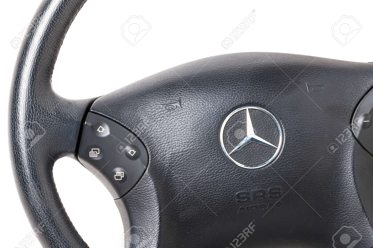 Novosibirsk, Russia - 10.30.2020: Spare part and interior element from a Mercedes-Benz car driver steering wheel on a white isolated background. Auto service industry. - 168105842