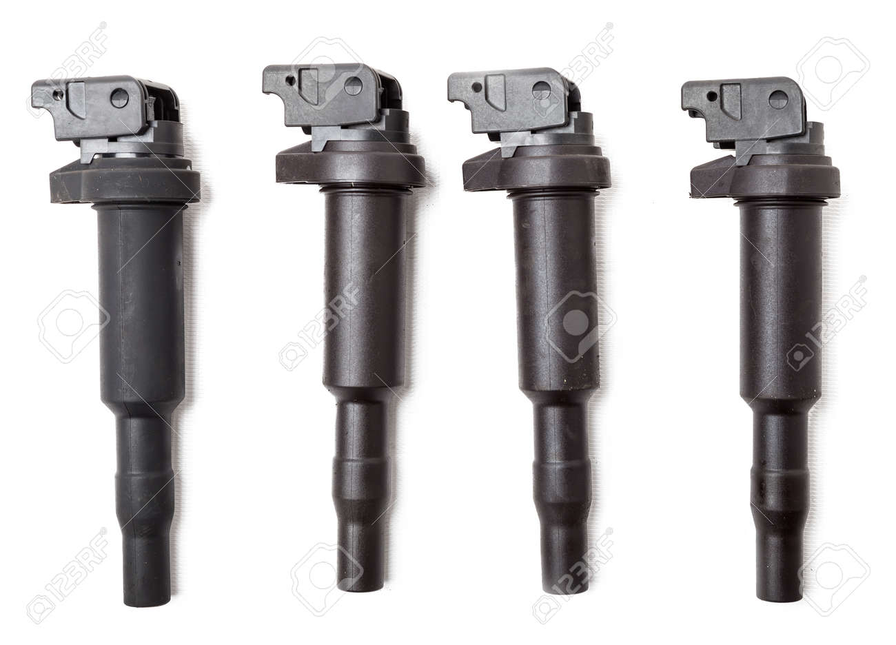 Four ignition coils for an internal combustion engine of a car during repair and service on a white isolated background. Spare parts catalog. - 169051390