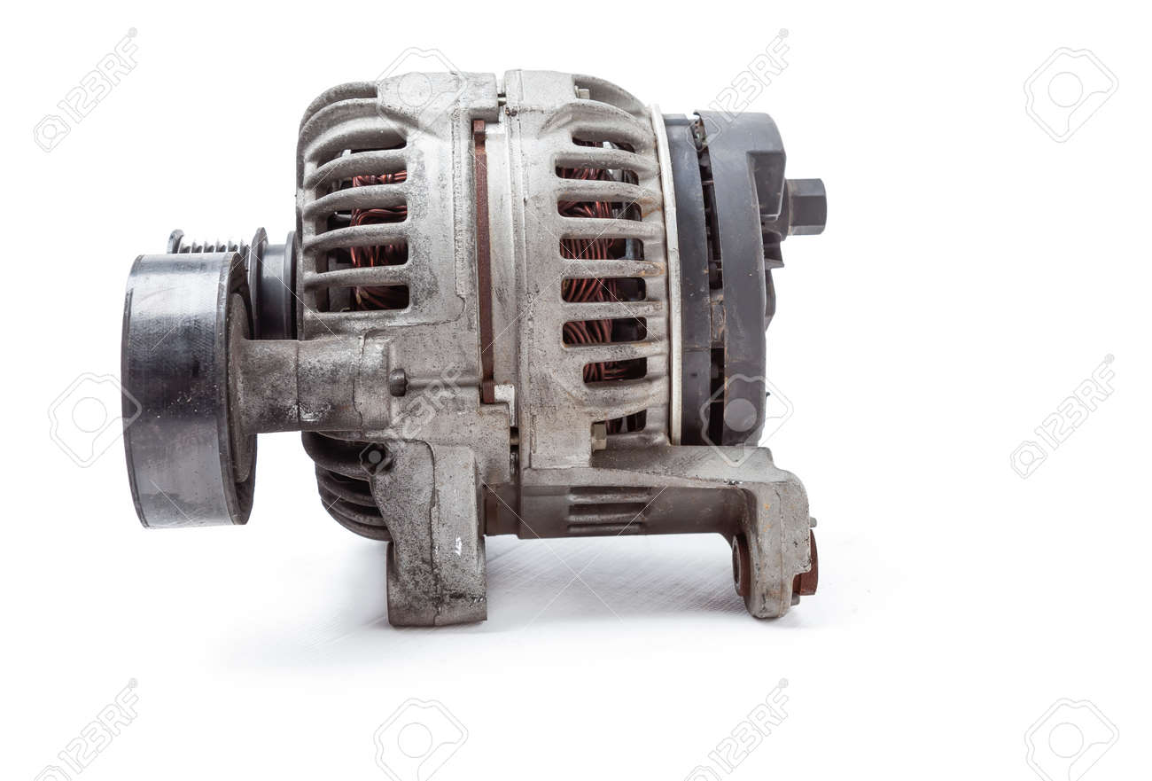 car spare part DC generator for charging the battery and providing electricity to the car's on-board network on a white isolated background. catalog of spare parts for vehicles from the junkyard. - 169051396