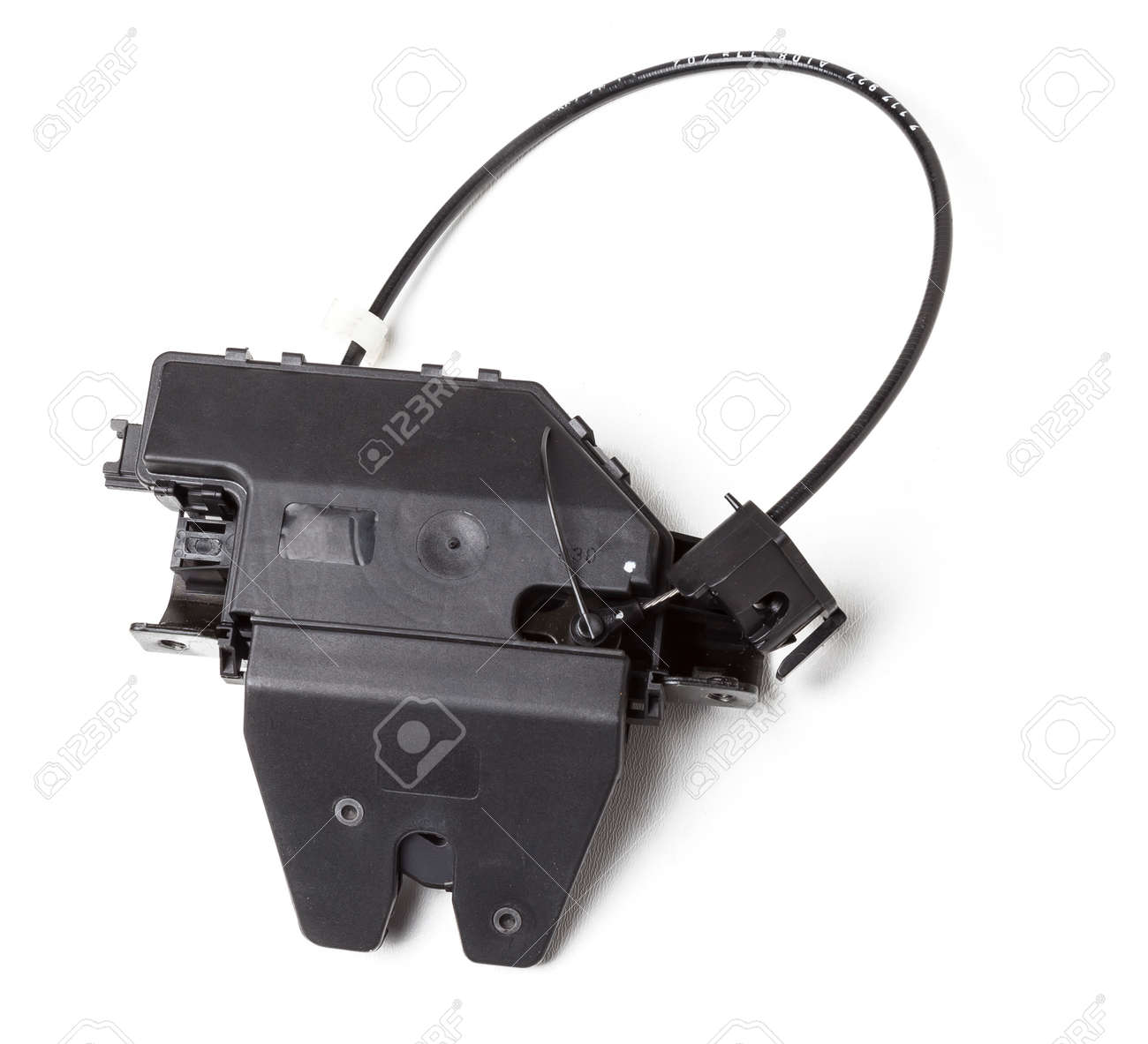 Detail of a car spare part made of black plastic and metal - rear trunk lock separately isolated on a white background. Repair in a car workshop, equipment for sale. - 169387995