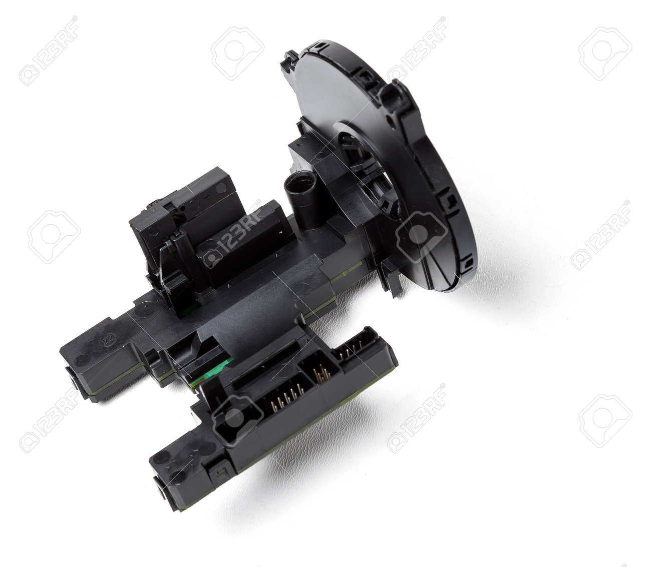 steering angle sensor disassembled on a white isolated background, spare part for car repair or for sale at junk yard. - 169388033