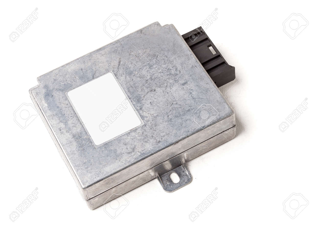 Plastic car engine control unit with metal elements on a white isolated background is the connecting center of various subsystems, units and assemblies. Monitoring the state of the moment. Spare part - 169387993