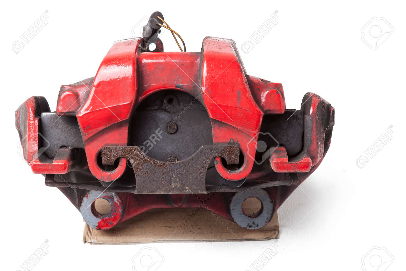 Red metal brake caliper on a white background in a photo studio for replacement during the repair of the chassis or for a catalog of spare parts for sale on auto parsing. - 169388036