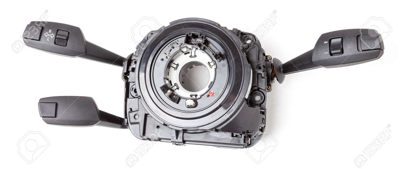 Steering wheel switches for windshield wipers and turn signals with steering angle sensor disassembled on a white isolated background, spare part for car repair or for sale at junk yard. - 169388040