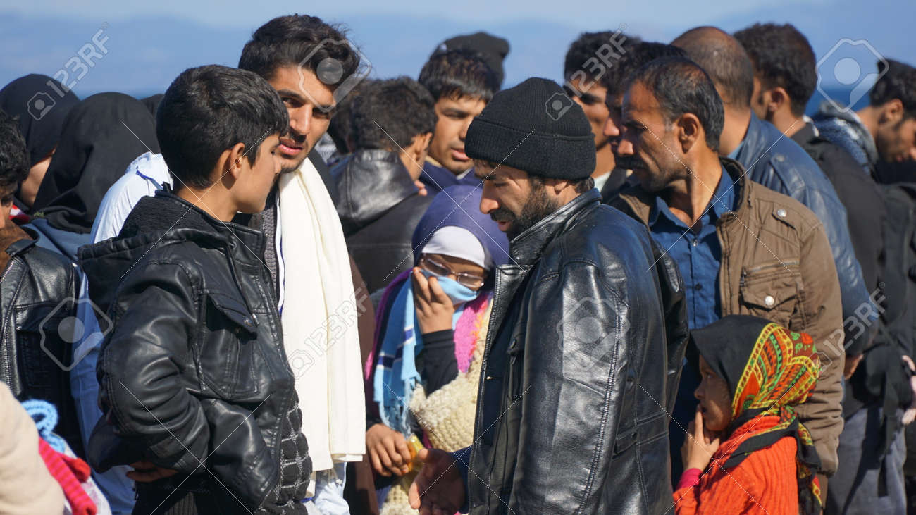 Refugees on the Greek shore - 52115223