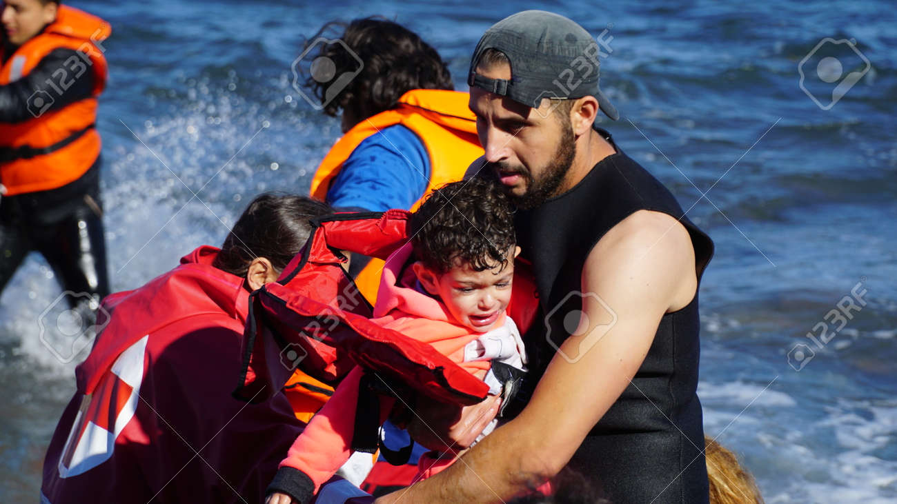 Children are pulled out of the boat. - 52115213