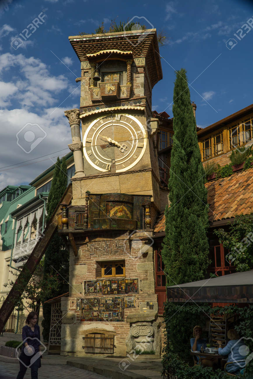 TBILISI, GEORGIA - SEP 25, 2016: The leaning clock tower of Rezo Gabriadze Marionette Theatre. - 77282283