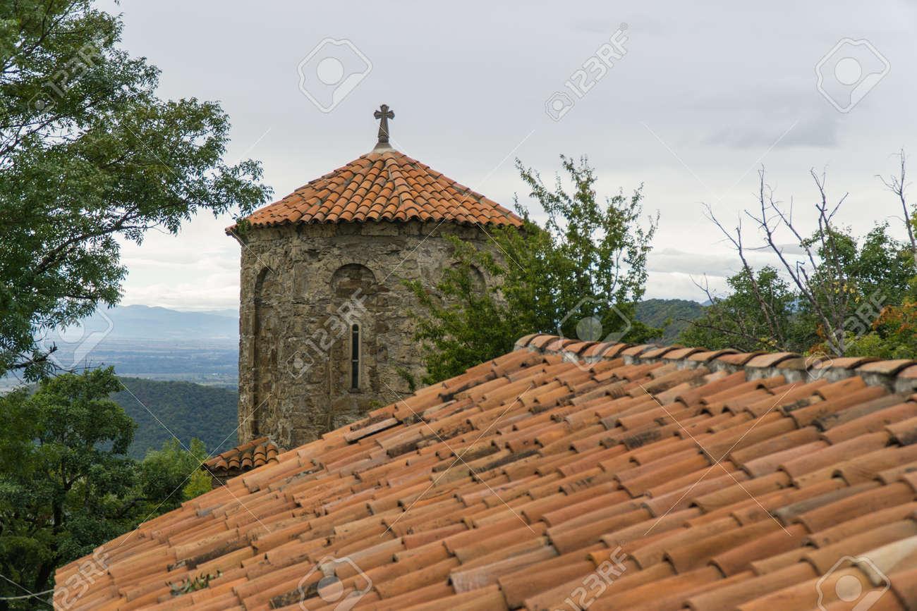 The monastery of the Dormition of the Theotokos in Nekresi. Kakheti, Georgia. Cloudy day - 77051649