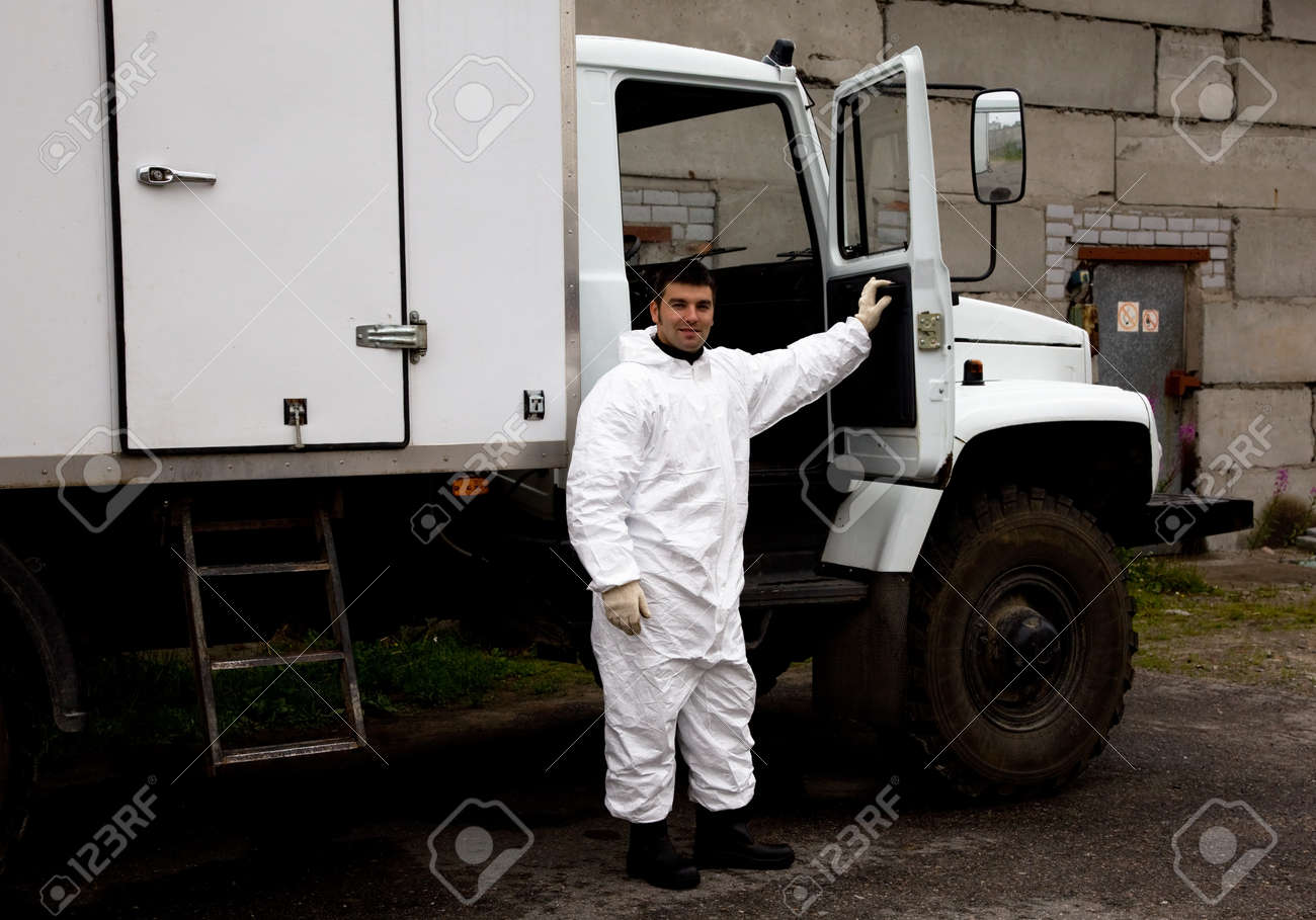 Nuclear plant worker in a white protective suit Stock Photo - 15358906