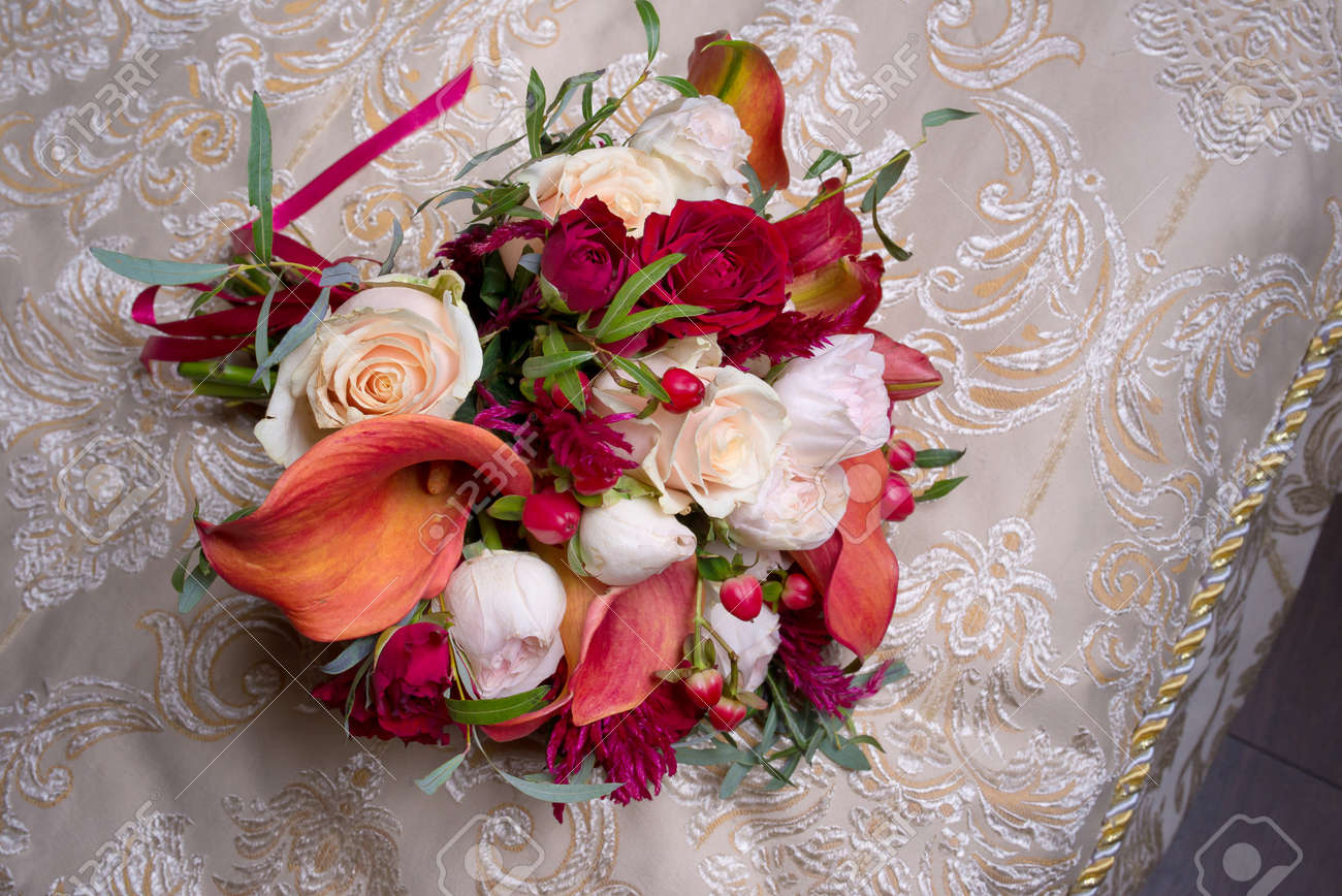 Wedding Bouquet With White And Red Roses And Red Calla Lilies Stock