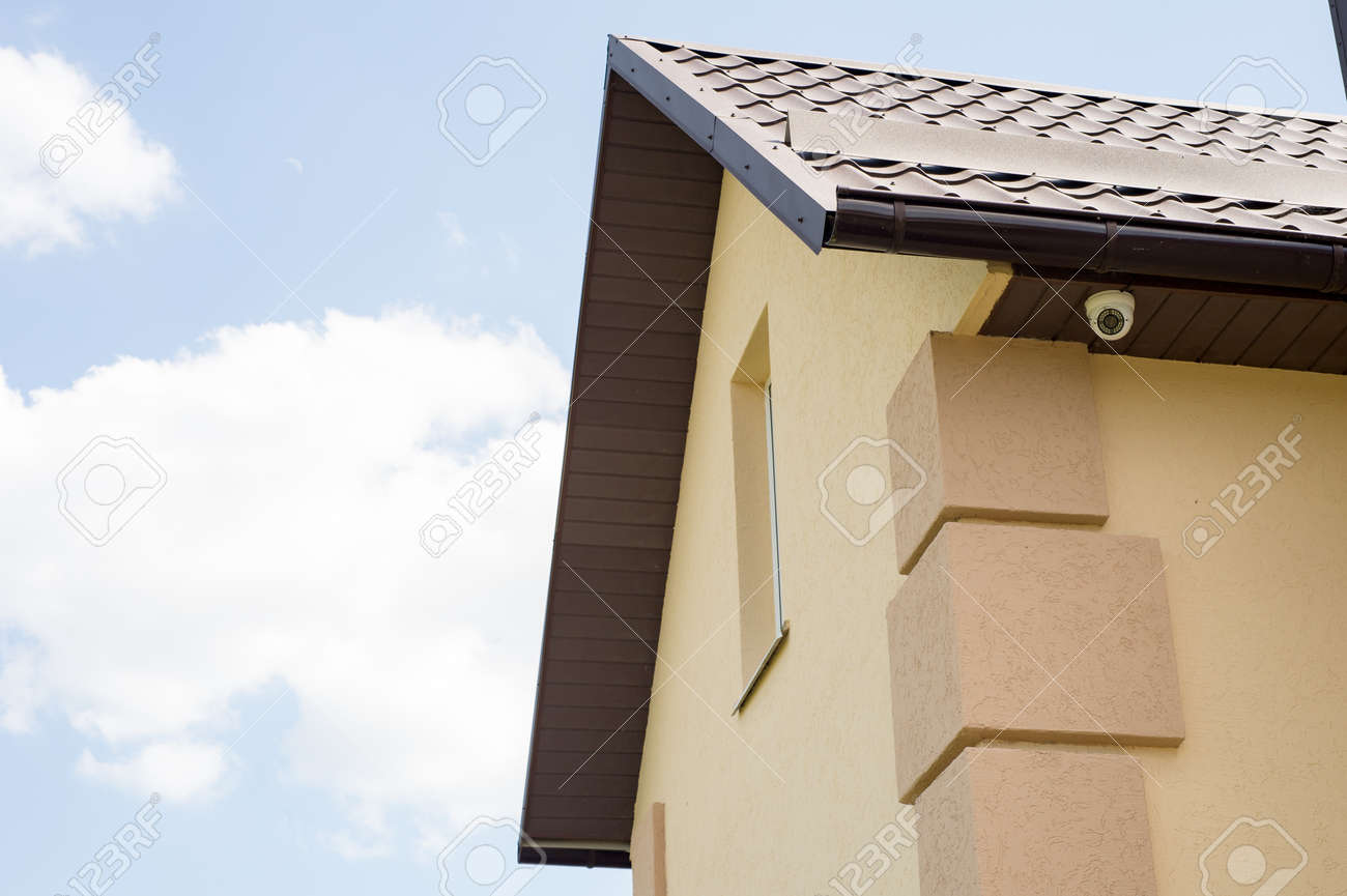 Modern Private House With A Surveillance Camera On It, Beautiful Sky  Background Stock Photo