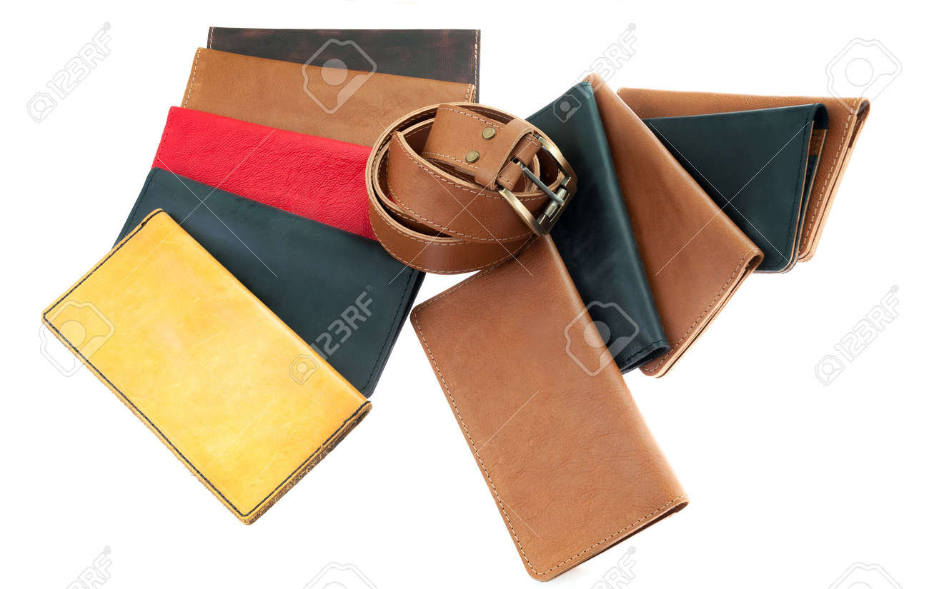 multi-colored leather wallets and a belt. leather accessories and products  isolated on white 6718e8ab6c203