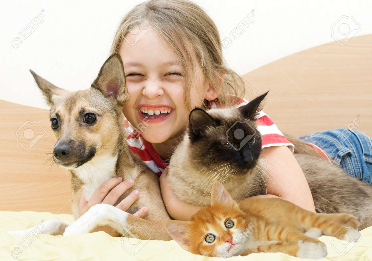 laughing girl and pets - 50919629