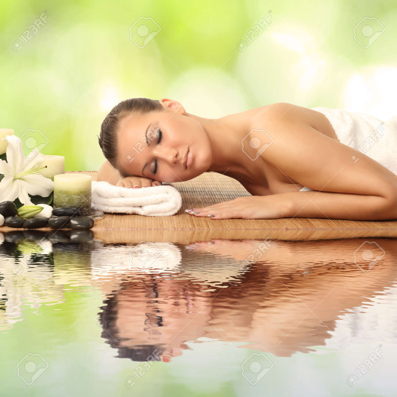 woman in spa salon lying on the massage desk Stock Photo - 25064964