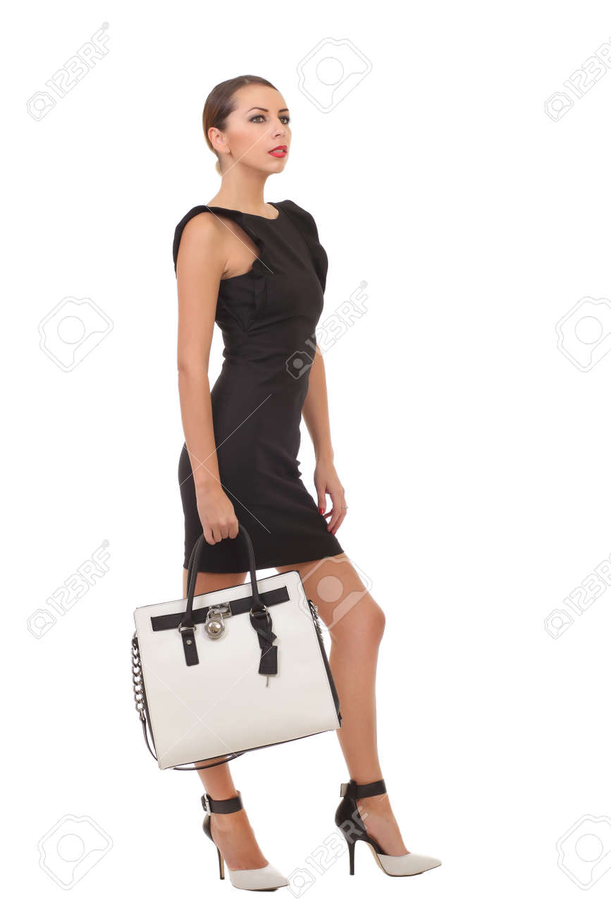 Woman In A Black Dress With A Bag In His Hands Stock Photo ...
