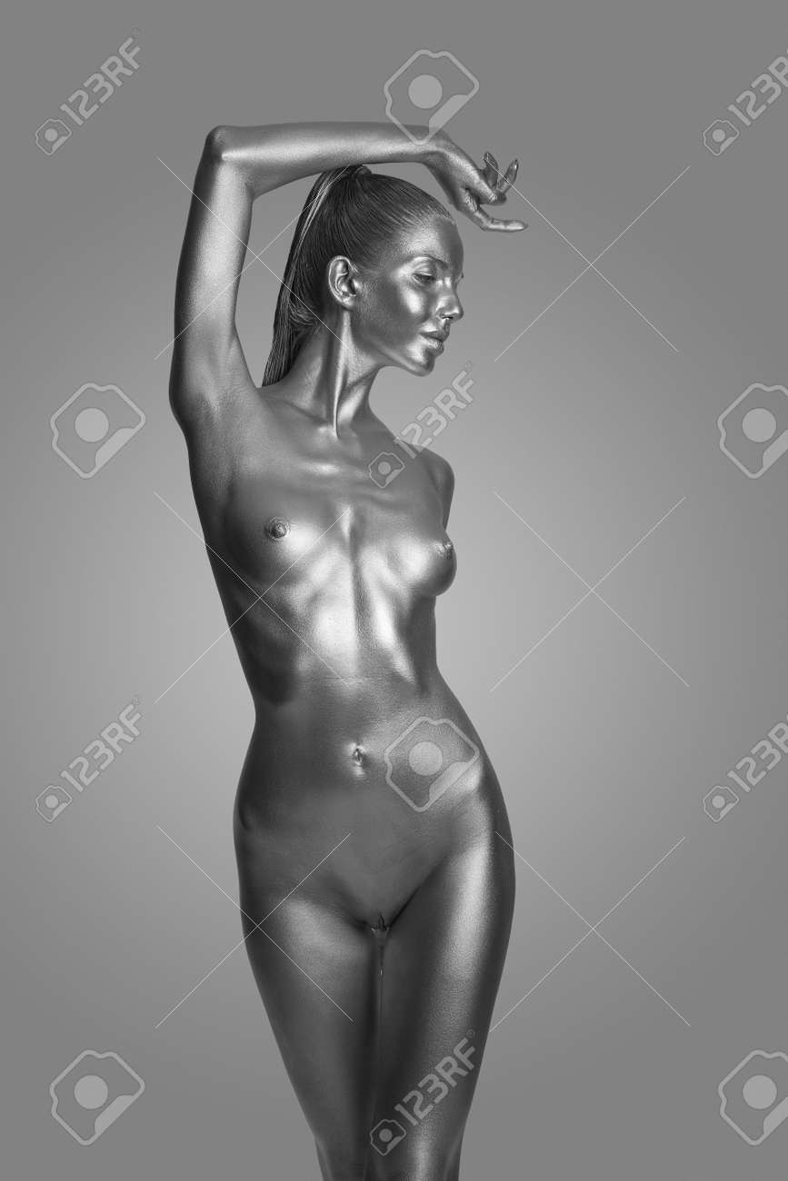 Naked Female Body In A Silver Body Painting