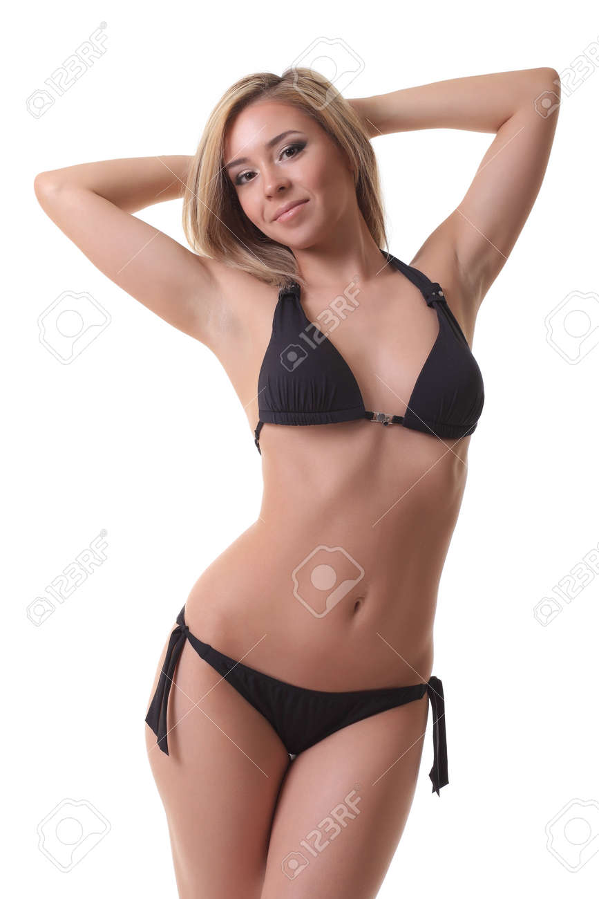 d45ca724aaa Young girl in black bikini posing on white background Stock Photo - 77338821