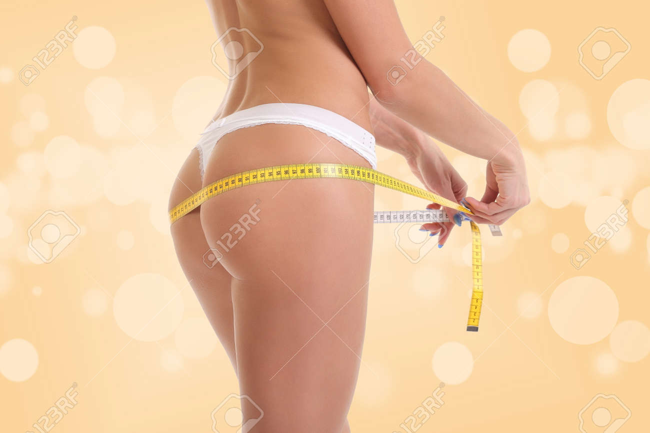 Stock Photo Young Girl In White Underwear Measures Her Ass