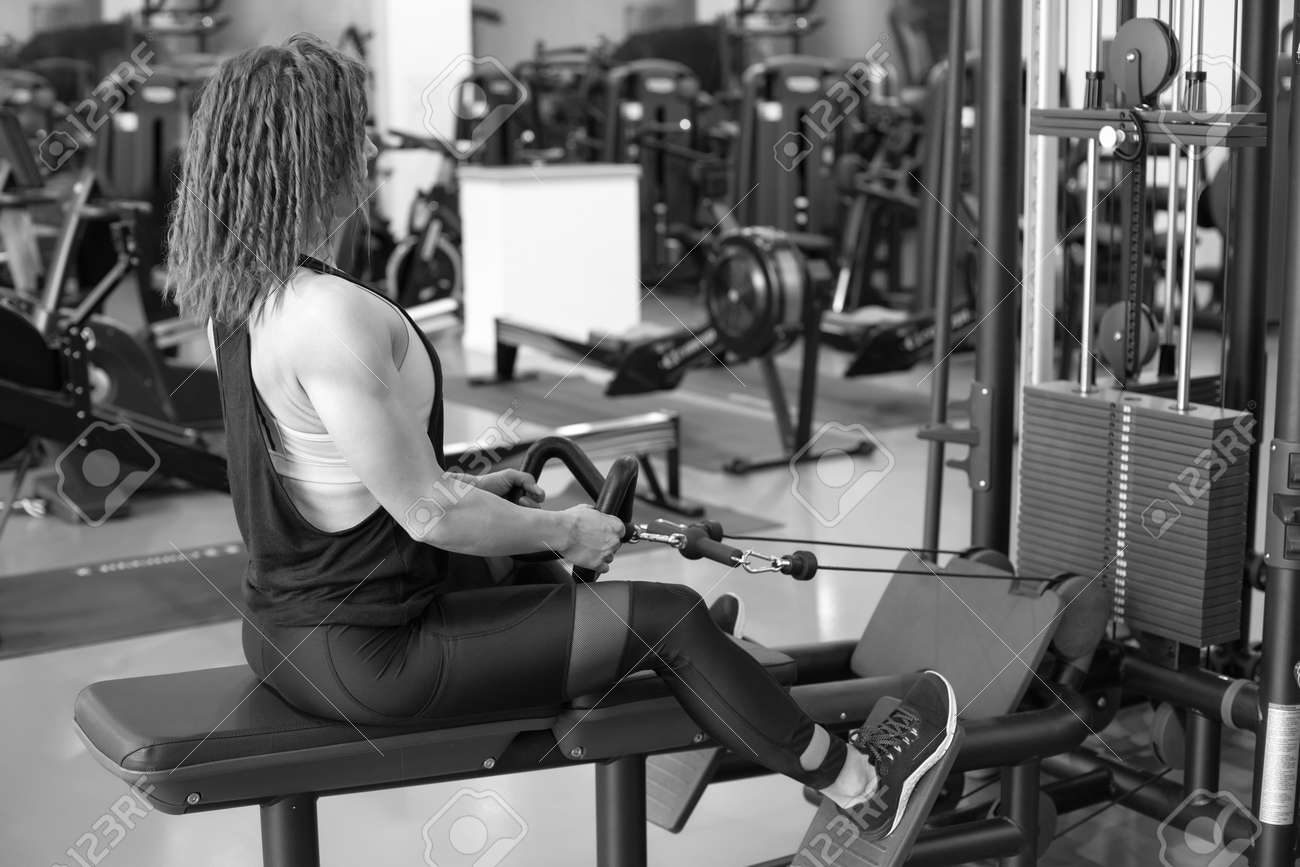 Sexy young athletic girl working out in gym. - 142648870