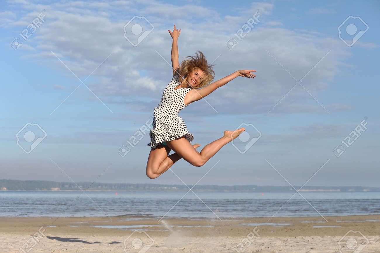 Beautiful young woman enjoying summer outdoors - 153642519